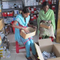 HCW_at_work_sorting_medicine_in_pharmachy_at_AKCHK.wmfbcover